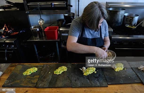 Chef Andrea Frizzi of Il Posto restaurant prepares a Venetian risotto dish called Saour at his restaurant in Denver Co on April 17 2014 The risotto...