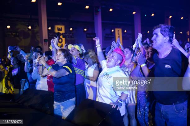 Chef Anna Polyviou celebrates during a performance by Daryl Braithwaite at the OzHarvest CEO Cookoff on March 25 2019 in Sydney Australia
