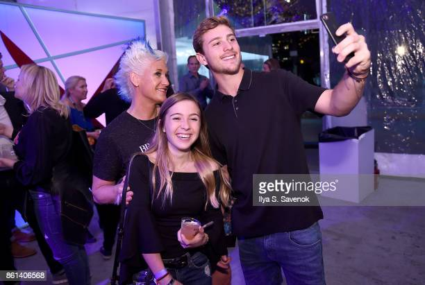 Chef Anne Burrell poses with fans at the Food Network Cooking Channel New York City Wine Food Festival presented by CocaCola Rooftop Iron Chef...