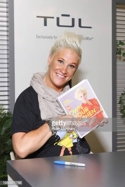 Chef Anne Burrell poses with her book in the TUL Exclusively for Office Depot Office Max booth at the Food Network Cooking Channel New York City Wine...