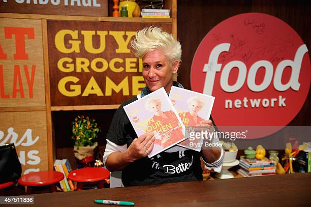 Chef Anne Burrell poses with her book 'Own Your Own Kitchen' at the Grand Tasting presented by ShopRite featuring KitchenAid® culinary demonstrations...
