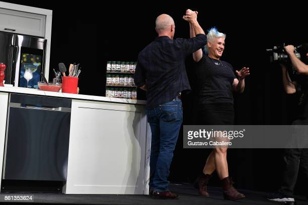 Chef Anne Burrell prepares a dish at the Food Network Cooking Channel New York City Wine Food Festival presented by CocaCola Grand Tasting presented...