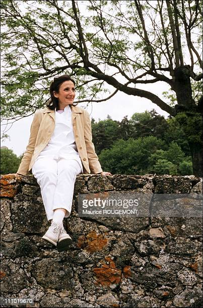 Chef AnneSophie Pic sitting on the wall of the former Auberge du Pin in Saint Peret which was the cradle of the family in Valence France on February...