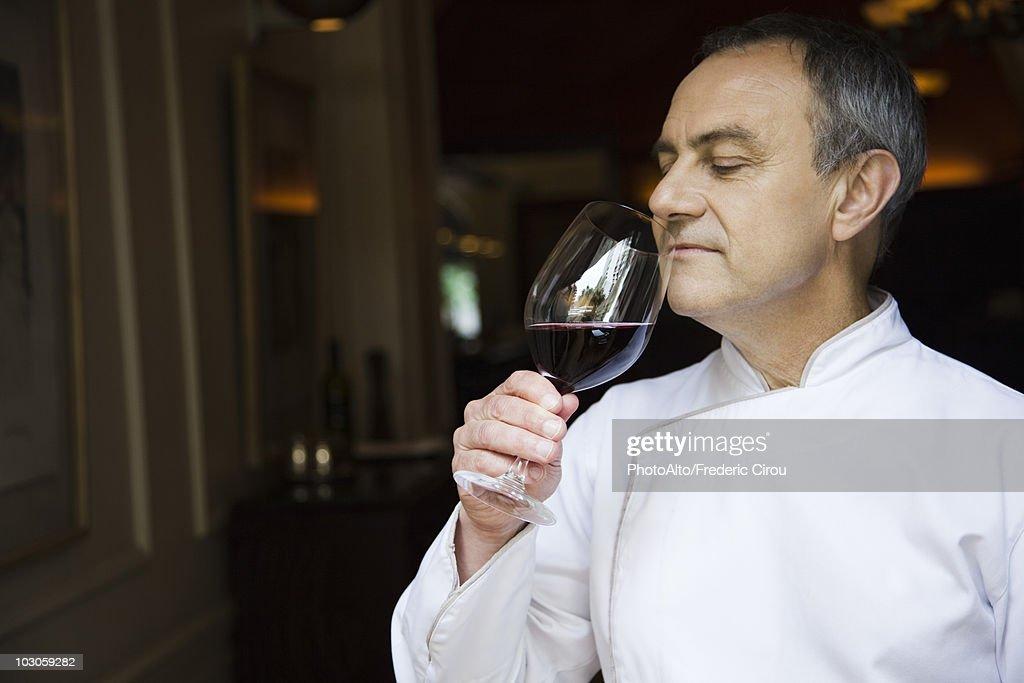 Chef appreciating wine bouquet : Stock Photo