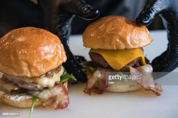 Chef assembles burgers