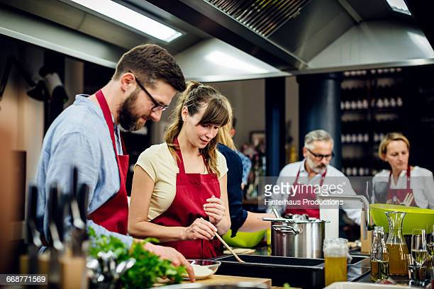 Chef assisting a cooking class