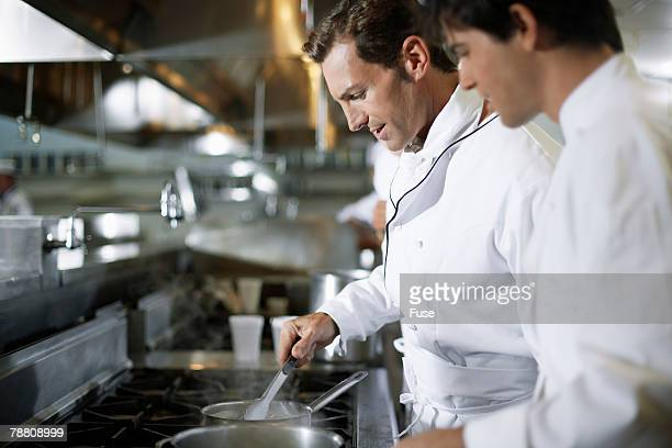 Chef Assisting Co-Worker