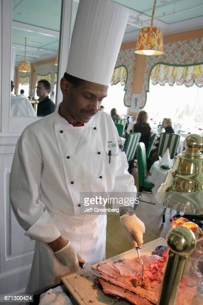 A chef at the carving station in the Main Dining Room at the Grand Hotel