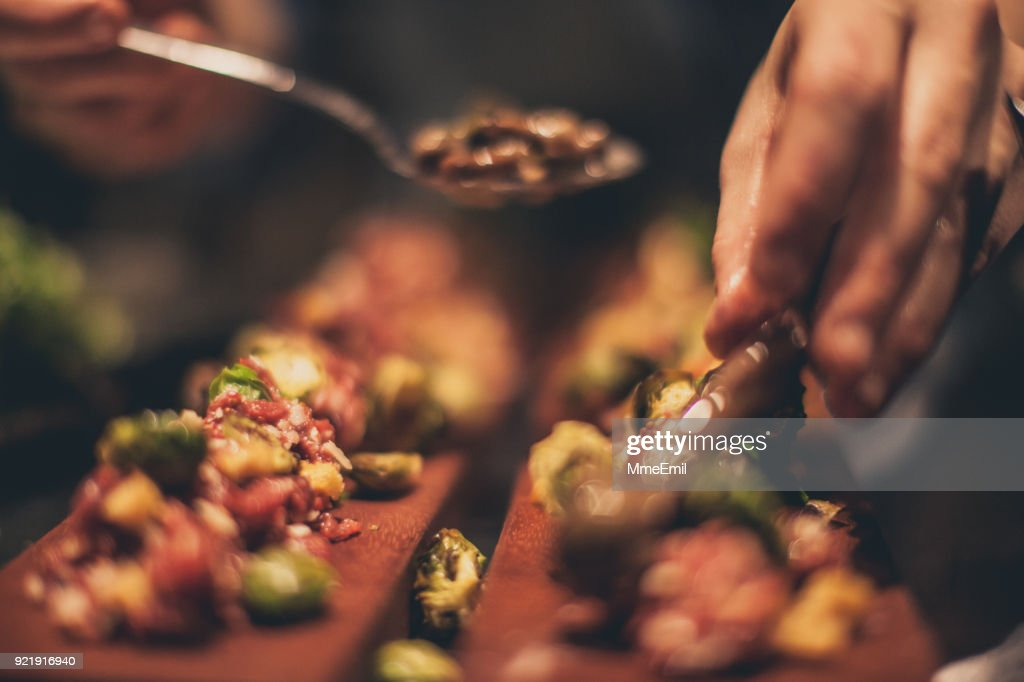 Chef At Work. Caterer Cooking In Commercial Kitchen : Stock Photo