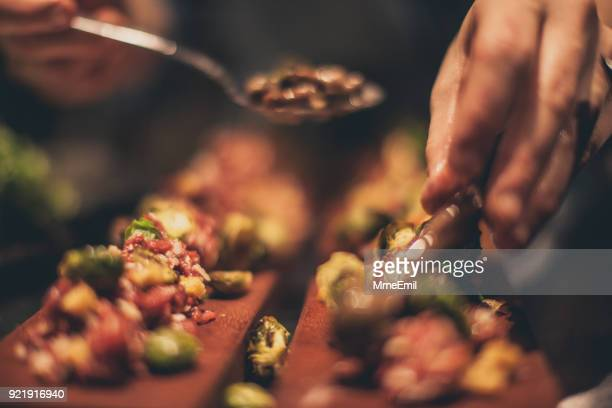 chef at work. caterer cooking in commercial kitchen - tapas stock photos and pictures