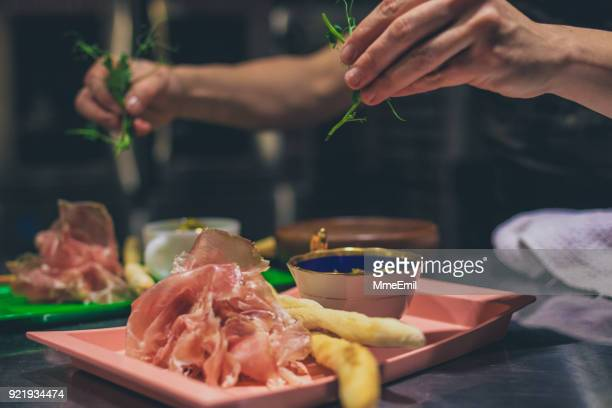 chef at work. caterer cooking in commercial kitchen - tapas imagens e fotografias de stock
