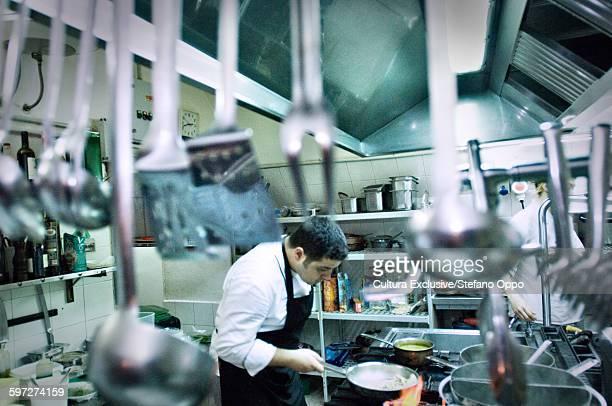 Chef at work in restaurant, Alghero, Sardinia, Italy