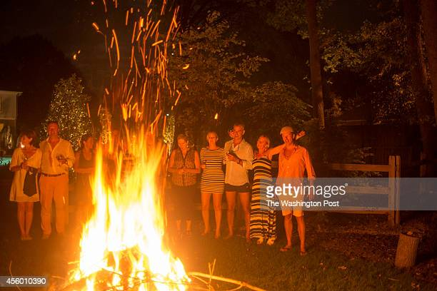 Chef Bart Vandaele enjoys a bonfire with his guests at his home in Alexandria Virginia on September 06 2014