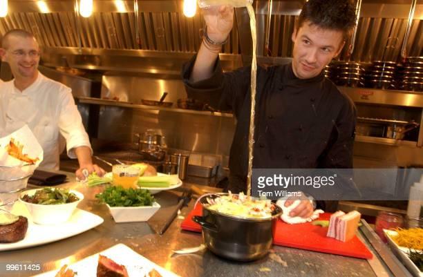 Chef Bart Vandaele prepares a mussels dish at Belga Cafe on 8th St SE