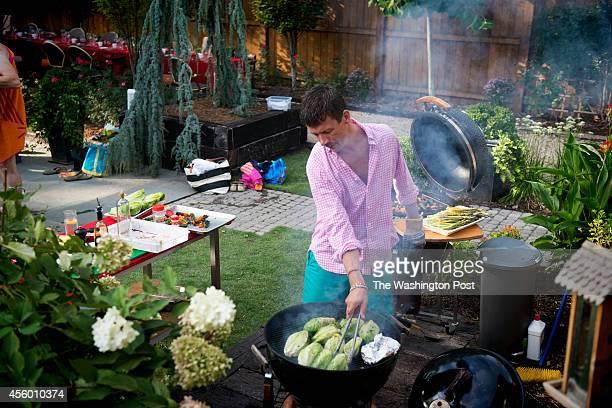 Chef Bart Vandaele preparing dinner for guest at his home in Alexandria Virginia on September 06 2014