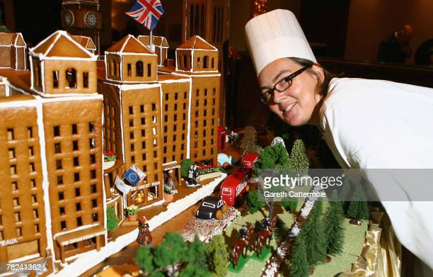 Chef Beate Woellstein poses with her gingerbread Houses of Parliment and London Eye creation at the Grosvenor House Hotel on December 4 2007 in...