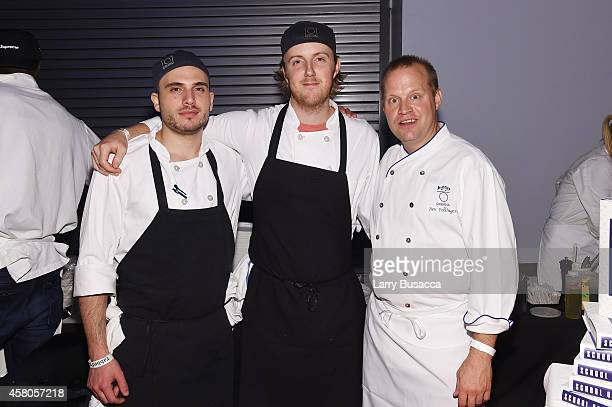 Chef Ben Pollinger poses with staff from Oceana at City Harvest's 20th annual Bid Against Hunger on October 29 2014 in New York City
