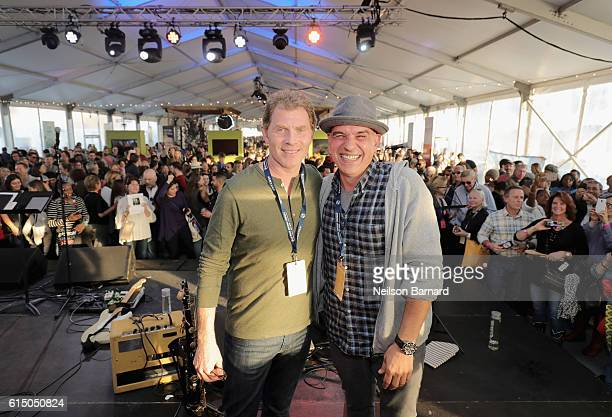 Chef Bobby Flay and Chef Michael Symon speak onstage at the CocaCola Backyard BBQ hosted by Bobby Flay and Michael Symon presented by Thrillist...
