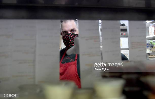 Chef Brandon Bryan looks over some orders to go out on a delivery on March 27 2020 in Portland Oregon Local Portland club The Lucky Devil started a...