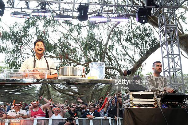 Chef Brandon Jew and DJ ATrak of Duck Sauce prepare food during the Duck Sauce Soiree at the GastroMagic Stage during day 2 of the 2014 Outside Lands...