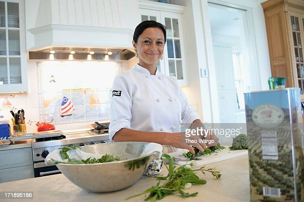 Chef Brie Munoz prepares food at Mentor's Brunch during The 18th Annual Nantucket Film Festival on June 29 2013 in Nantucket Massachusetts