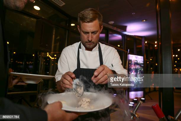 Chef Bryan Voltaggio prepares a dessert during Capital One Celebrates The Launch Of The New Savor Card During A Priceless Table Presented By...