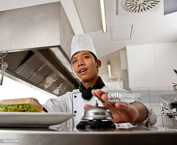 chef calling a waitress for her order