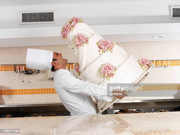 Chef Carrying Wedding Cake