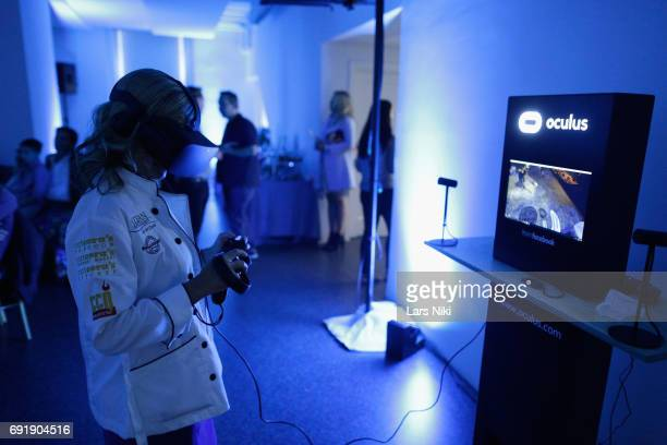 Chef Cat Cora uses Oculus VR at the Beauty and the Beast film at the Celebrity Chef Cat Cora Celebrates the InHome Release of BEAUTY AND THE BEAST...