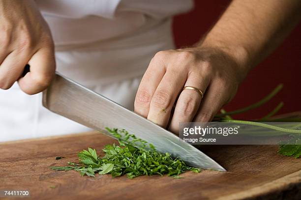 chef chopping parsley - chop stock pictures, royalty-free photos & images