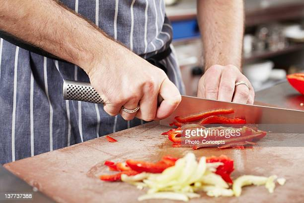 chef chopping vegetables in kitchen - chop stock pictures, royalty-free photos & images