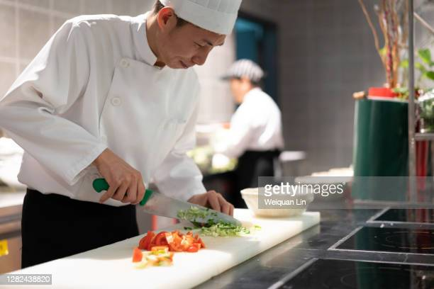 chef chopping vegetables in the kitchen - fujian province stock pictures, royalty-free photos & images