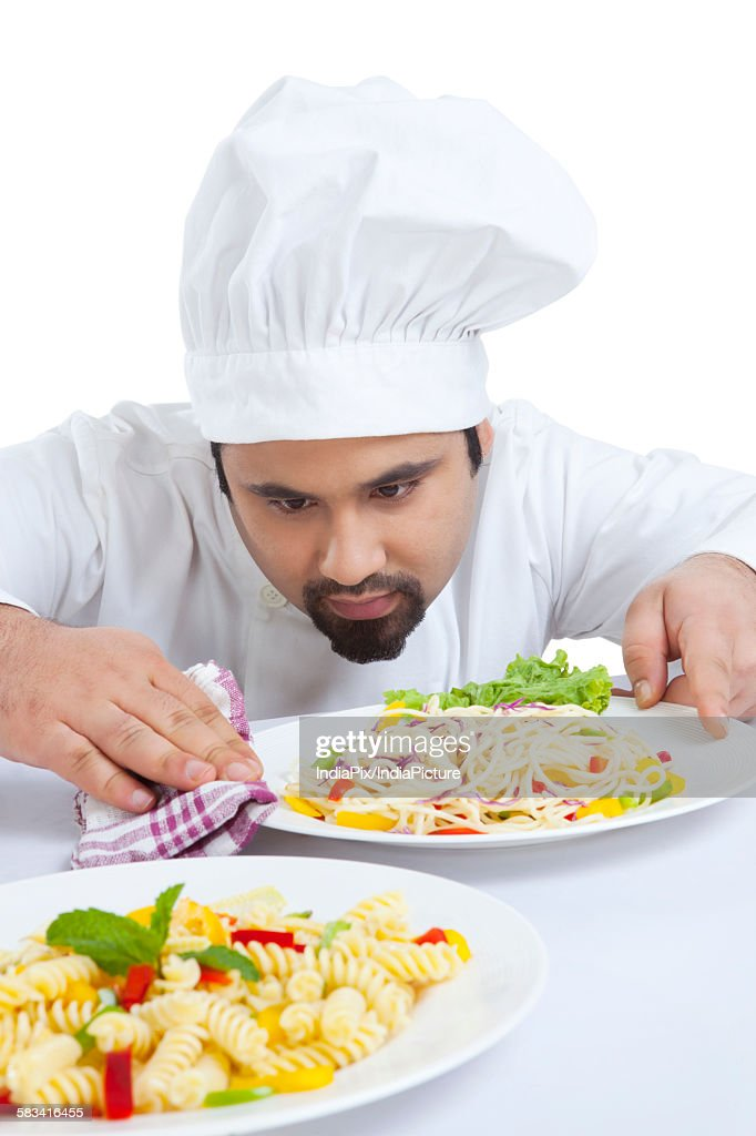 Chef cleaning side of plate : Stock Photo