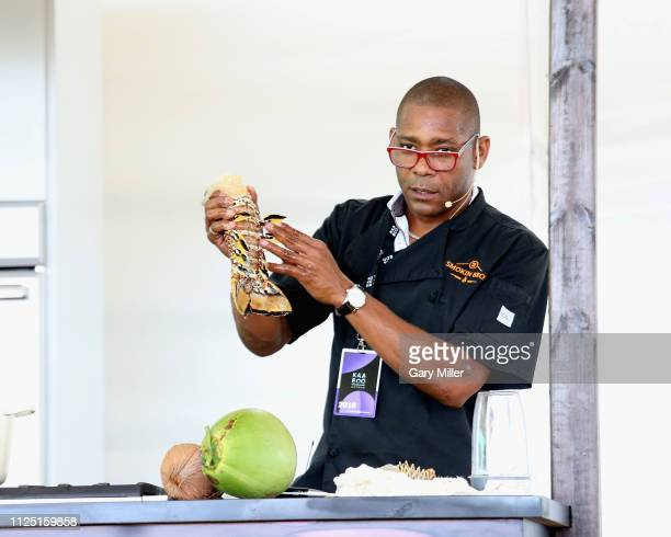 Chef Cody Bush gives a cooking demonstration during the sold out inaugural KAABOO Cayman Festival at Seven Mile Beach on February 15 2019 in Grand...
