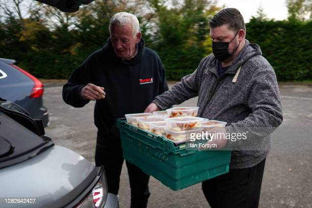 Chef Colin Woodward and volunteer driver Michael Woodward load meals for delivery to food banks at the Mill restaurant in Stokesley on October 28,...