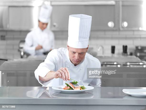 chef completing fish - chef's hat stock pictures, royalty-free photos & images