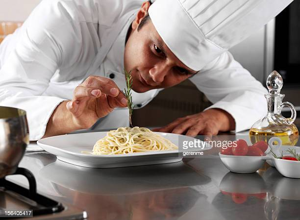 chef completing pasta - arranging stock pictures, royalty-free photos & images