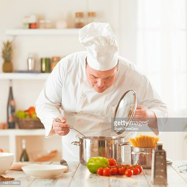 chef cooking a vegetable soup