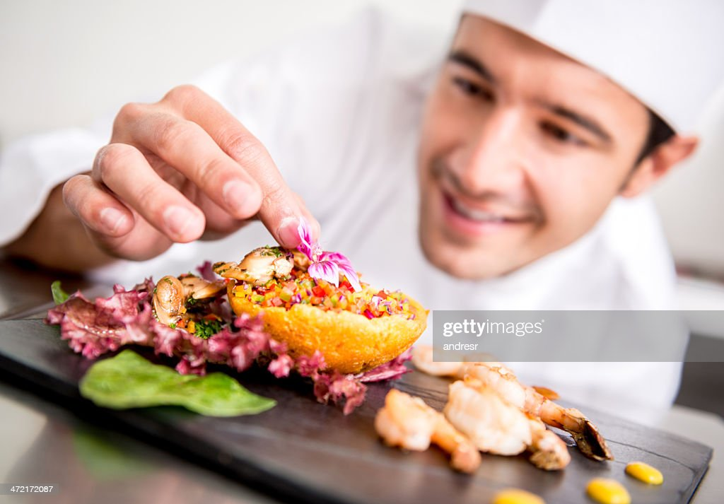 Chef cooking at the restaurant : Stock Photo