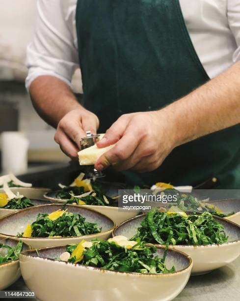 chef cooking in the industrial kitchen - food service occupation stock pictures, royalty-free photos & images