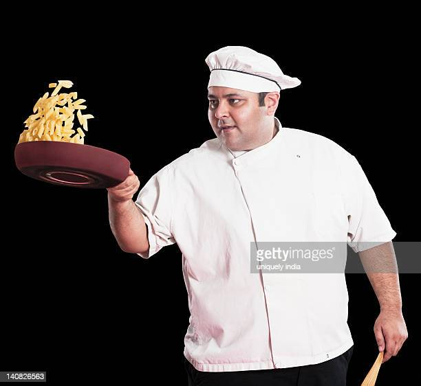 Chef cooking penne pasta