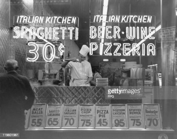 A chef cooking spaghetti at an Italian restaurant on 42nd Street Manhattan New York City 1953