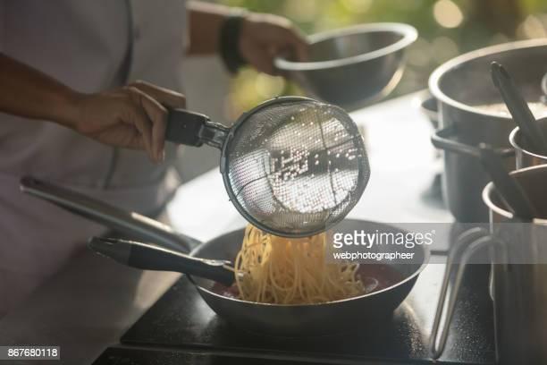 Chef cooking spaghetti