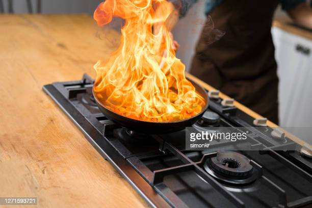 chef cooking vegetables in pan - burning stock pictures, royalty-free photos & images
