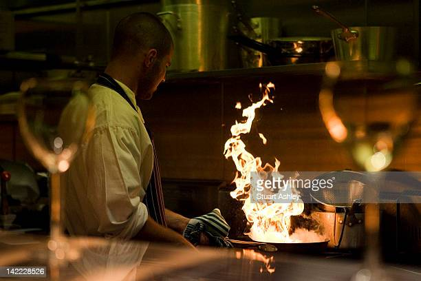 chef cooking with fire in frying pan - passion stock pictures, royalty-free photos & images