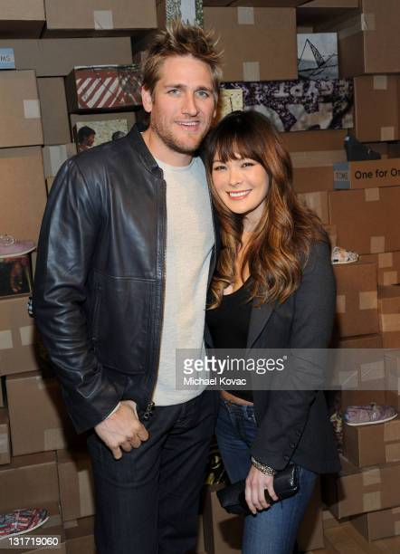Chef Curtis Stone and actress Lindsay Price attend the launch of TOMS spring 2011 collection inspired by Dan Eldon at the TOMS Give Shop and Gallery...