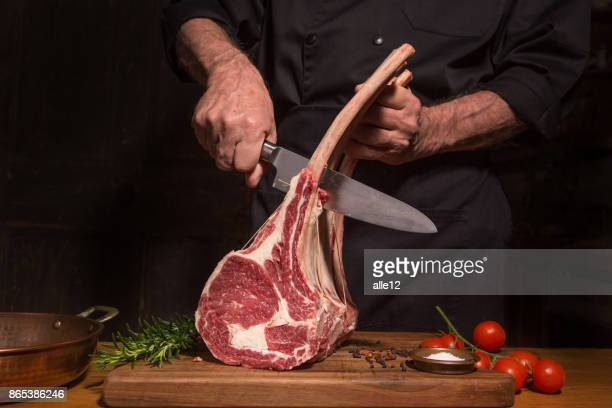 chef cutting beef - cutting stock pictures, royalty-free photos & images