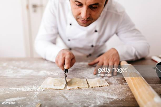 Chef cutting fresh ravioli