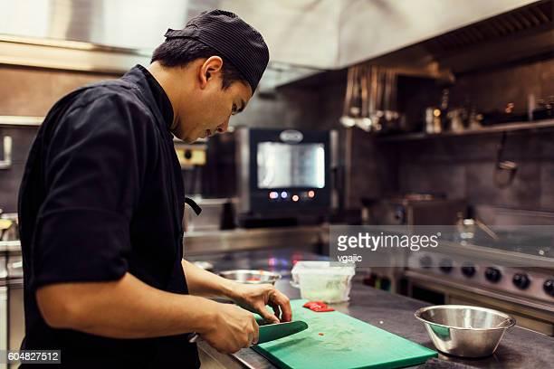 Chef Cutting Green Hot Paprika.