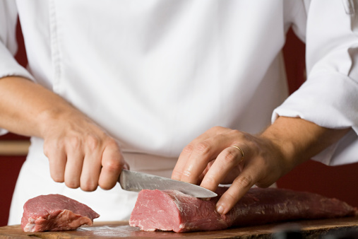 Chef cutting meat 74411643